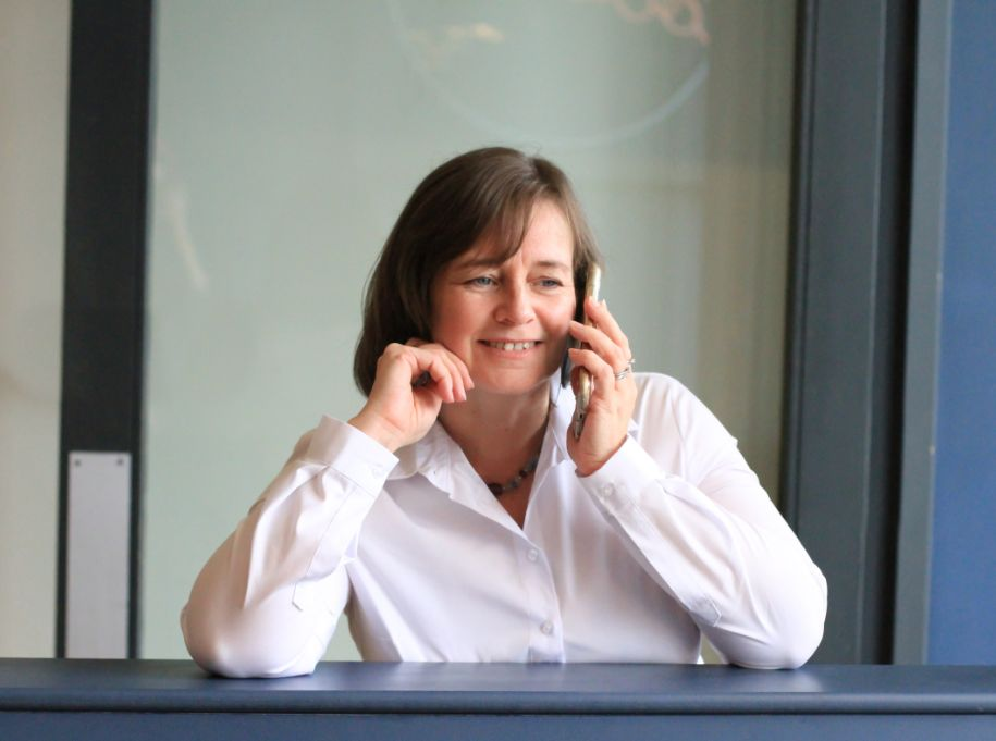 Freelance content writer Michelle on phone