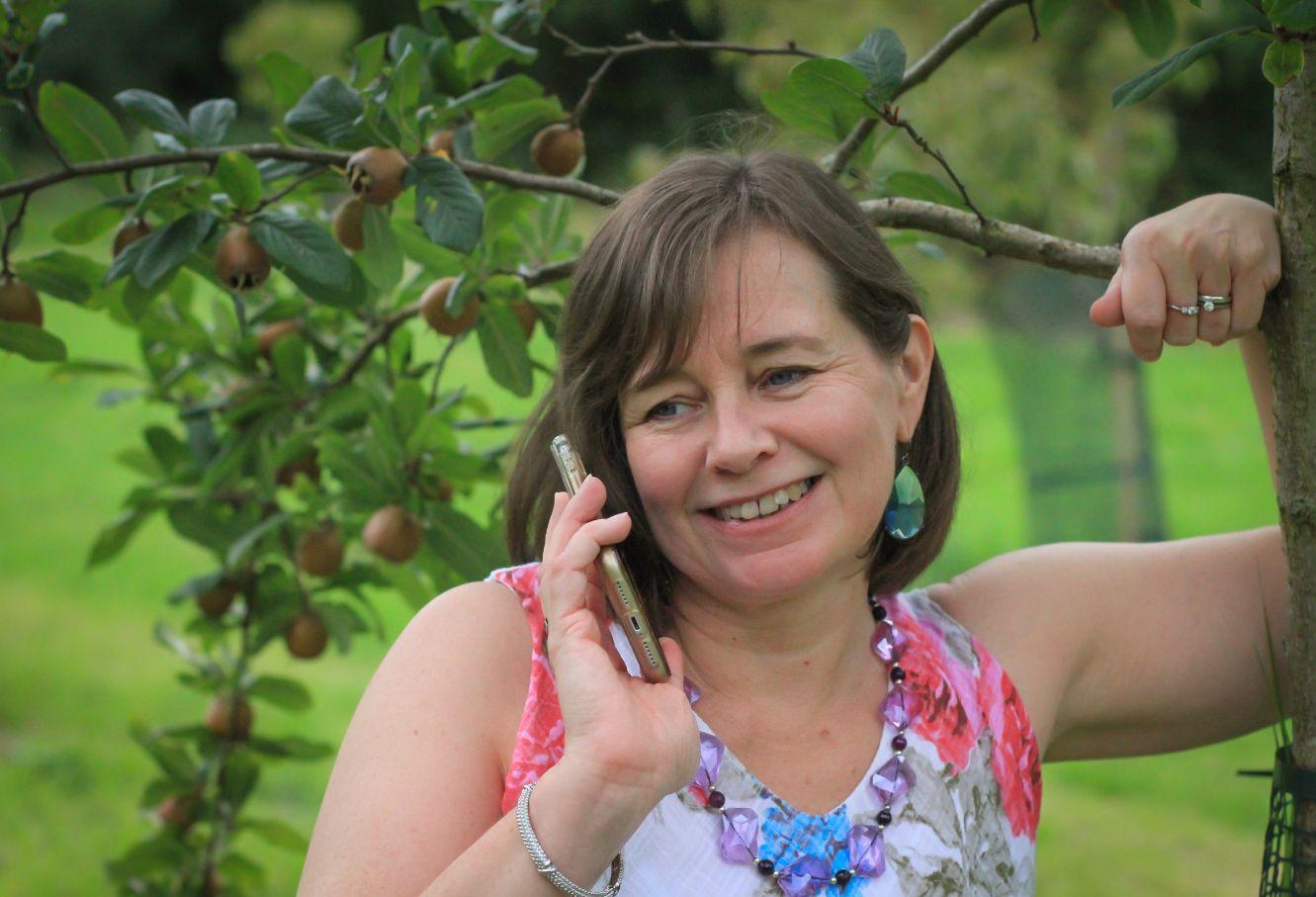 Freelance copywriter London Michelle on phone outside
